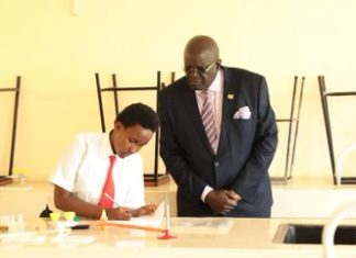 Education Cabinet Secretary George Magoha inspects 2019 KCSE Chemistry Practical exams in a Nairobi school. This year's Chemistry practical has been doffed by cheating claims and assertions that one of the reagents used is very poisonous.