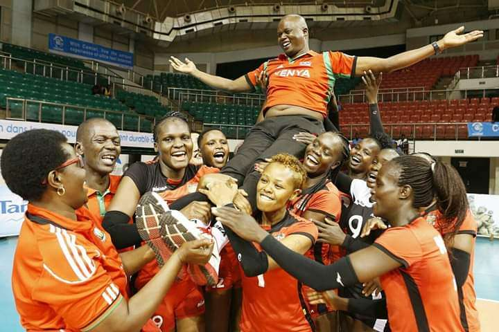 Malkia Strikers players carry their coach, Paul Bitok, in celebration after clinching their Olympics ticket.