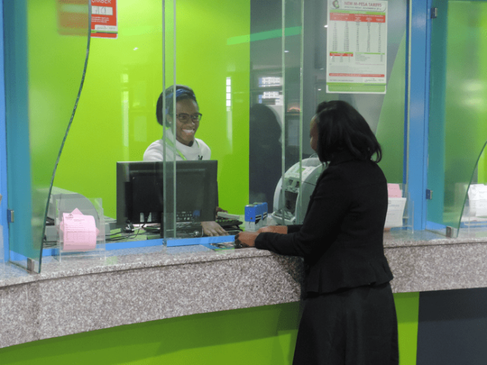 A customer receiving services at a Mwalimu National Sacco's office. The Sacco has urged members to acquire the new Go-Mobile Application for faster services.