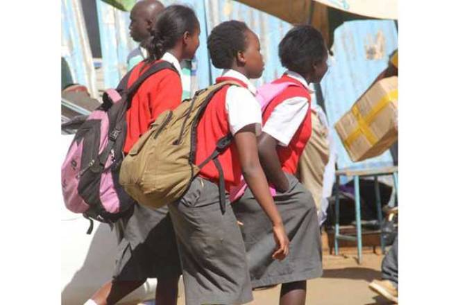 High school students. ANC leader Musalia Mudavadi has urged the government to provide a clear road map; post the Covid-19 pandemic.