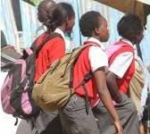Learners walk home after schools were closed. The government is finding itaself within a hard place and a rock on making a decision whether to reopen schools soon or not.