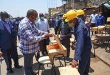 President Uhuru Kenyatta, left, launches the free school desks programme.