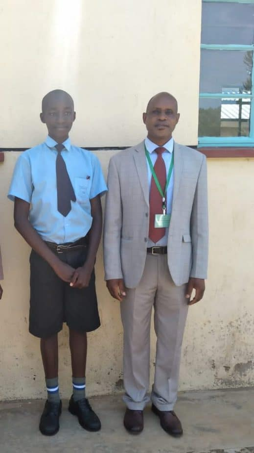 Head teacher of Eronge Adventist Boarding School in Nyamira County with Griffins Amwoma who scored 427 marks in KCPE 2020. Exam